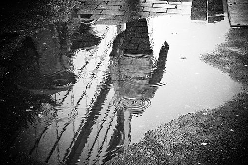 Urban Landscapes: Capturing the reflection in a puddle of water, on the streets