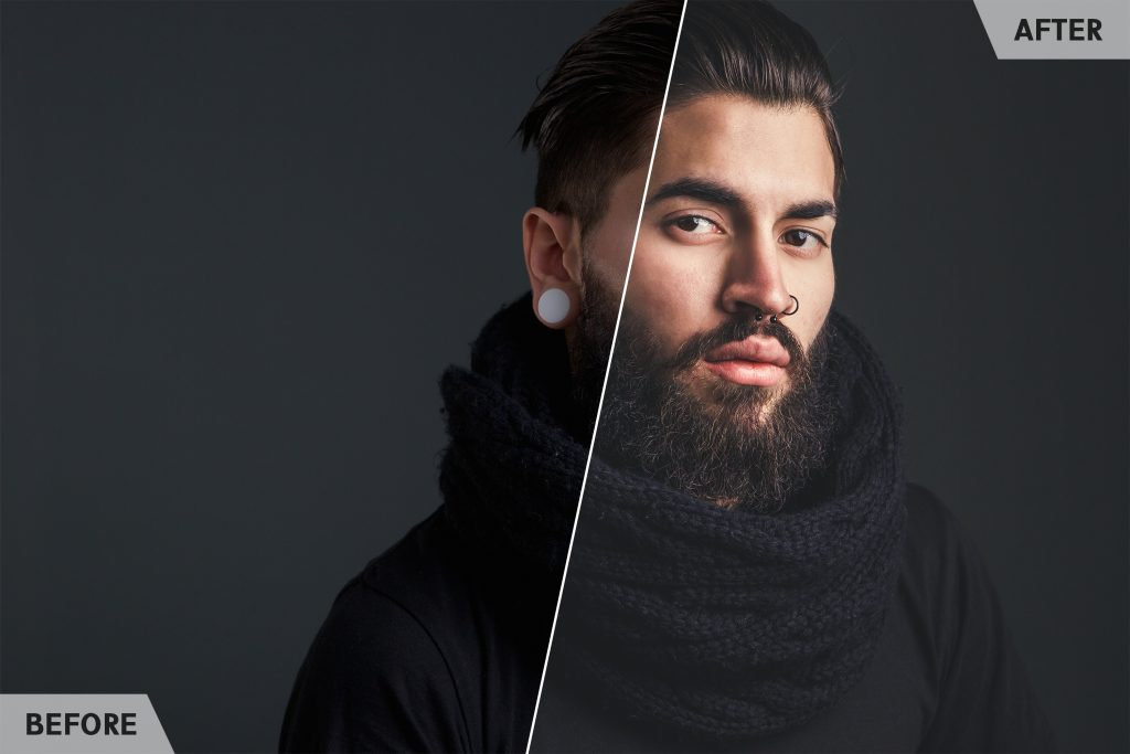 Close up portrait of a cool guy with beard and piercings